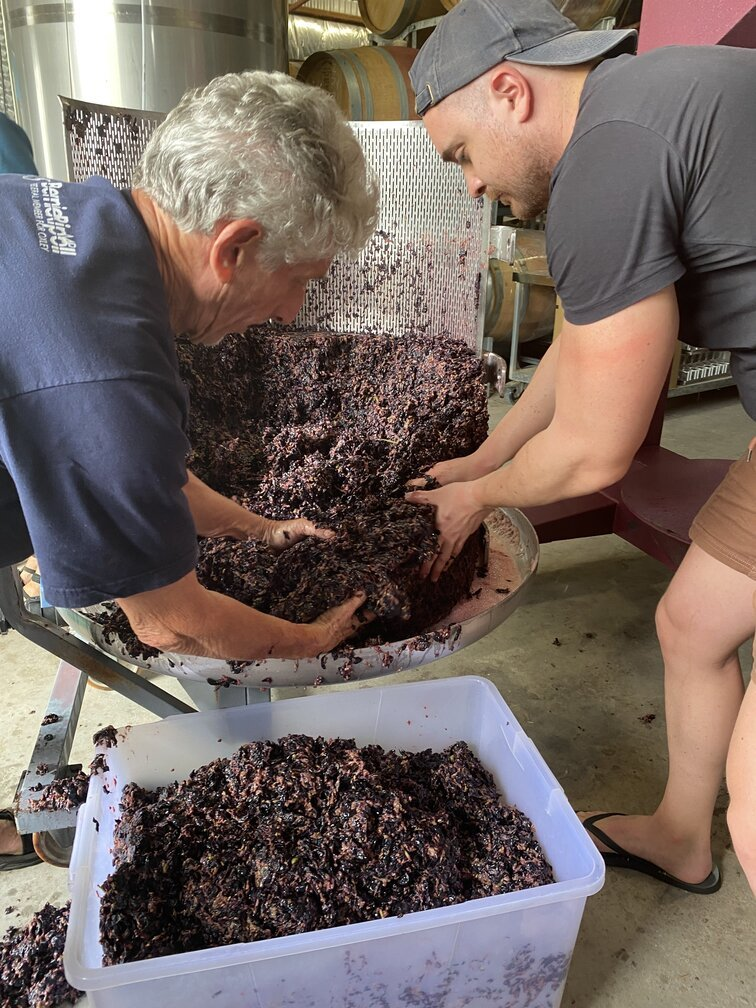 dirty work pressing grapes